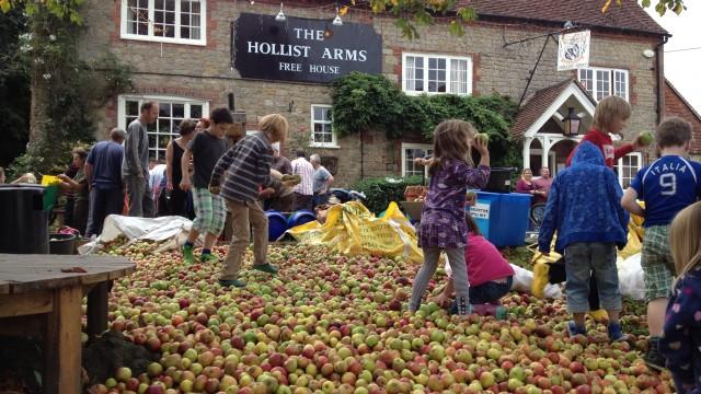 Apple Day celebration in Sussex makes involving local people with their heritage an involving, participatory  social event.