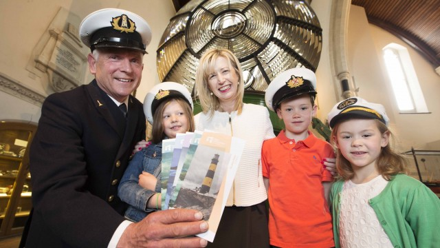 Former Lighthouse Keeper Gerald Butler and Yvonne Shields, Chief Executive of Commissioners of Irish Lights are joined by children to launch Great Lighthouses of Ireland