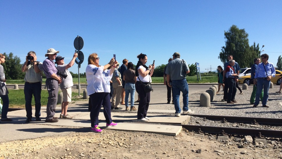 Visitors at Auschwitz Birkenau concentration camp in Poland taking photographs