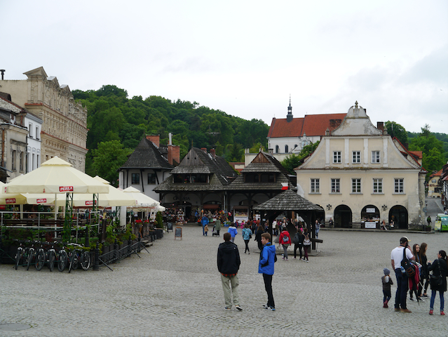 People wandering around the square in Kazimierz Dolny in Poland