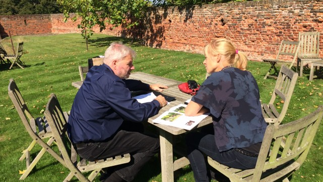 Two participants sat outside having a discussion during the InHerit Pilot Heritage Interpretation Training Course
