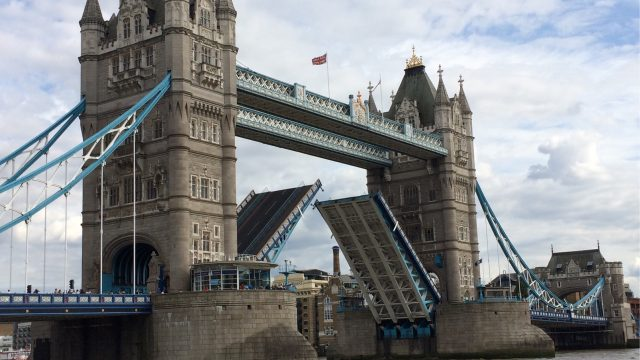 Susan CRoss trains staff in writing for overseas tourists at Tower Bridge.