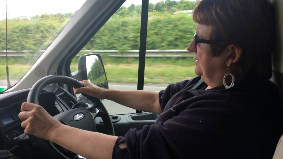 Susan Cross driving the camper van